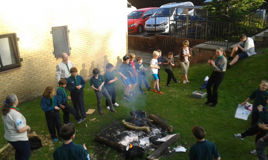 Cubs having a campfire